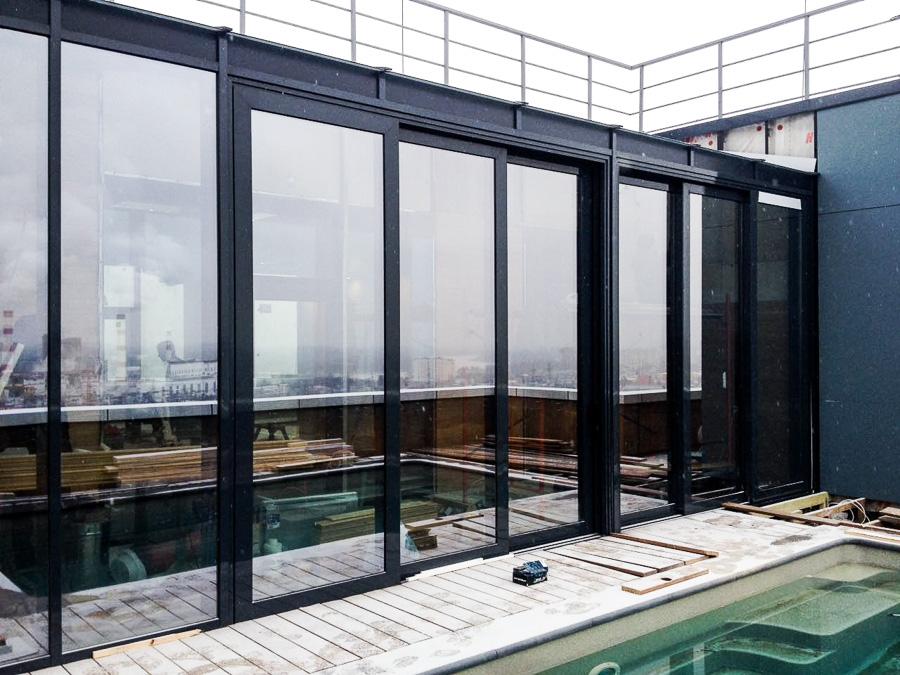 подъемно-сдвижные конструкции в остеклении бассейна